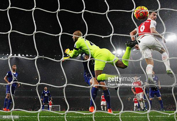 Laurent Koscielny of Arsenal scores his team's second goal past Tim Howard of Everton during the Barclays Premier League match between Arsenal and...