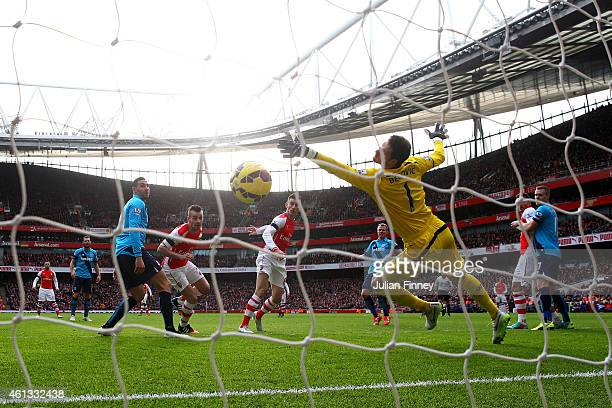 Laurent Koscielny of Arsenal scores the opening goal past Asmir Begovic of Stoke City during the Barclays Premier League match between Arsenal and...