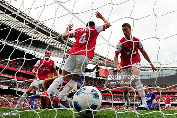 Laurent Koscielny of Arsenal shoots and scores the first goal of the game during the Barclays Premier League match between Arsenal and Bolton...