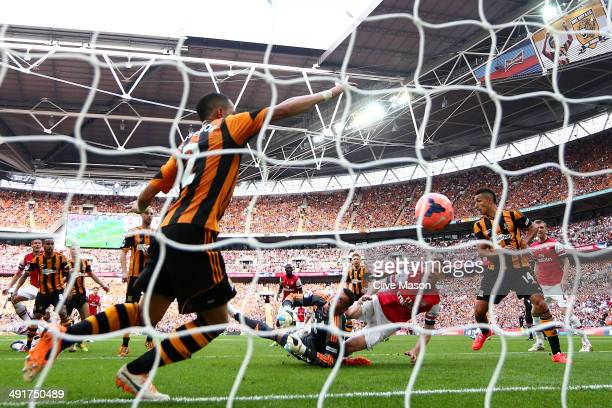 Laurent Koscielny of Arsenal shoots past goalkeeper Allan McGregor of Hull City as he scores their second goal during the FA Cup with Budweiser Final...