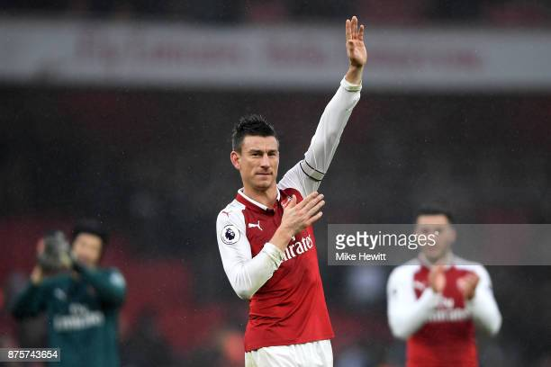 Laurent Koscielny of Arsenal shows appreciation to the fans after the Premier League match between Arsenal and Tottenham Hotspur at Emirates Stadium...