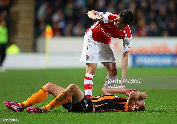 Laurent Koscielny of Arsenal stands over an injured David Meyler of Hull City during the Barclays Premier League match between Hull City and Arsenal...
