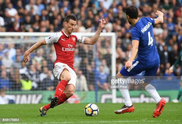Laurent Koscielny of Arsenal takes on Cesc Fabregas of Chelsea during the Premier League match between Chelsea and Arsenal at Stamford Bridge on...