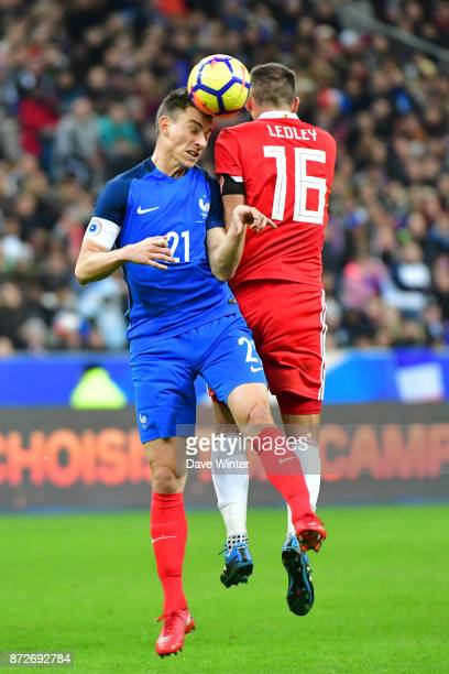Laurent Koscielny of France and Joe Ledley of Wales during the international friendly match between France and Wales at Stade de France on November...