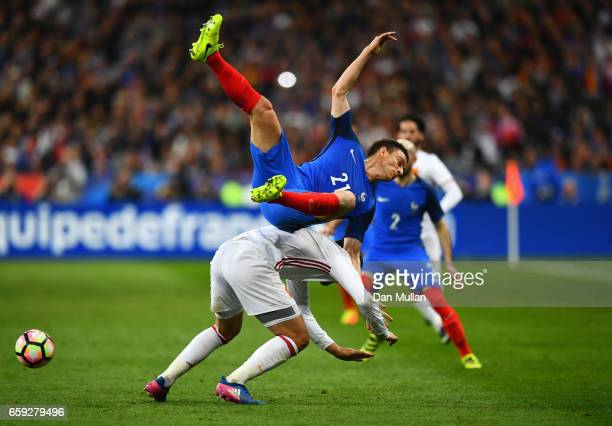 Laurent Koscielny of France clashes with Alvaro Morata of Spain during the International Friendly match between France and Spain at Stade de France...
