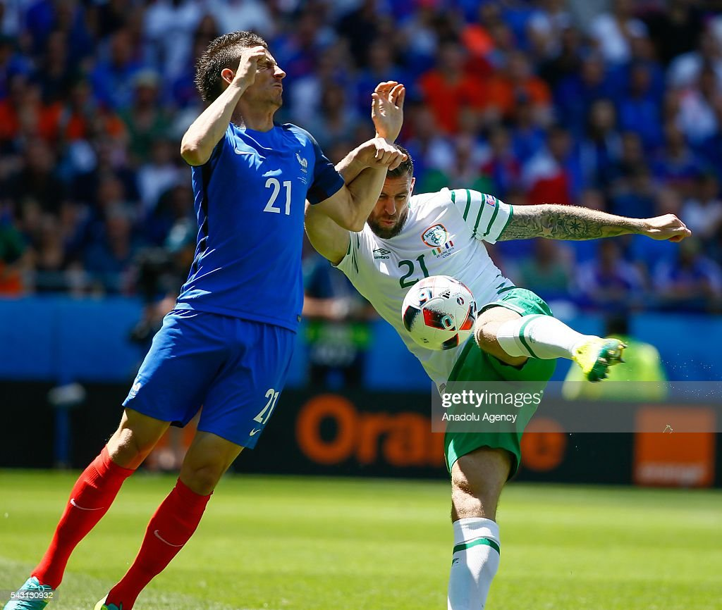 Laurent Koscielny (R) of France in action against Daryl Murphy of Ireland during the UEFA Euro 2016 Round of 16 football match between France and Ireland at the Stade de Lyon in Lyon, France on June 26, 2016.