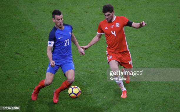Laurent Koscielny of France in action with Ben Davies of Wales during the friendly match between France and Wales at Stade de France on November 10...