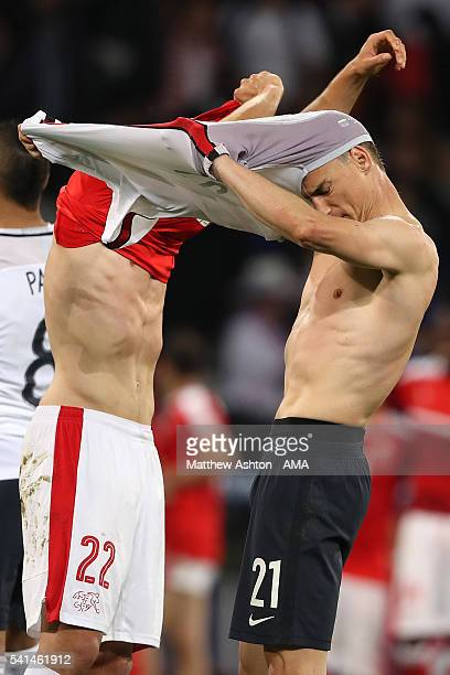 Laurent Koscielny of France swaps shirts with Fabian Schar of Switzerland at the end of the UEFA EURO 2016 Group A match between Switzerland and...