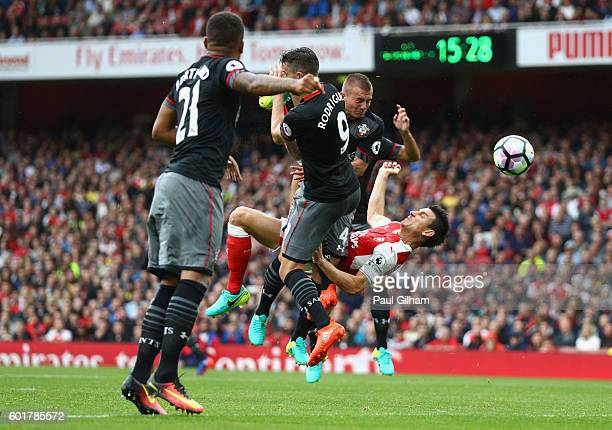 Laurent Koscielny of scores his sides first goal during the Premier League match between Arsenal and Southampton at Emirates Stadium on September 10...
