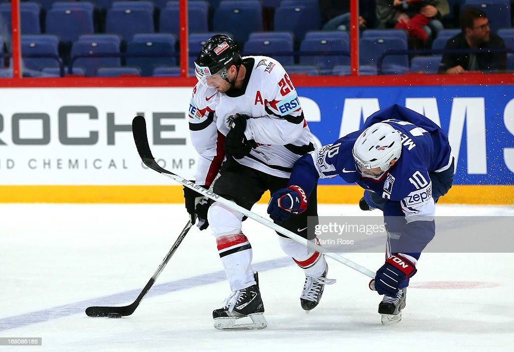 Laurent Meinier (R) of France and Thomas Vanek(L) of Austria battle for the puck during the IIHF World Championship group H match between France and Austria at Hartwall Areena on May 5, 2013 in Helsinki, Finland.