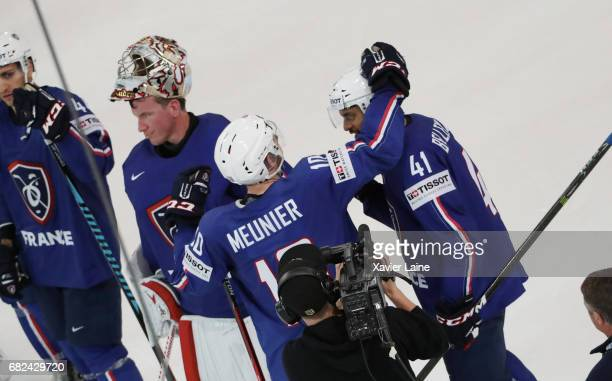Laurent Meunier PierreEdouard Bellemare and Cristobal huet of France celebrate the victory with teammattes during the 2017 IIHF Ice Hockey World...