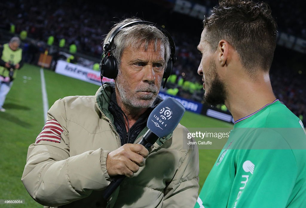 Laurent Paganelli of Canal Plus interviews Jeremy Clement of Saint-Etienne after the French Ligue 1 match between Olympique Lyonnais (OL) and AS Saint-Etienne (ASSE) at Stade de Gerland on November 8, 2015 in Lyon, France.