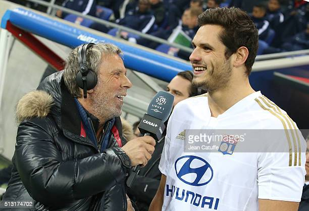 Laurent Paganelli of Canal Plus interviews olympic gold medalist in swimming Florent Manaudou during the French Ligue 1 match between Olympique...