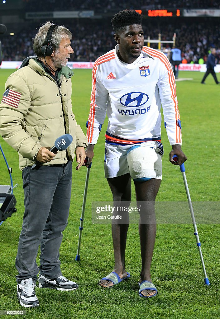 Laurent Paganelli of Canal Plus interviews <a gi-track='captionPersonalityLinkClicked' href=/galleries/search?phrase=Samuel+Umtiti&family=editorial&specificpeople=7123899 ng-click='$event.stopPropagation()'>Samuel Umtiti</a> of Lyon after the French Ligue 1 match between Olympique Lyonnais (OL) and AS Saint-Etienne (ASSE) at Stade de Gerland on November 8, 2015 in Lyon, France.
