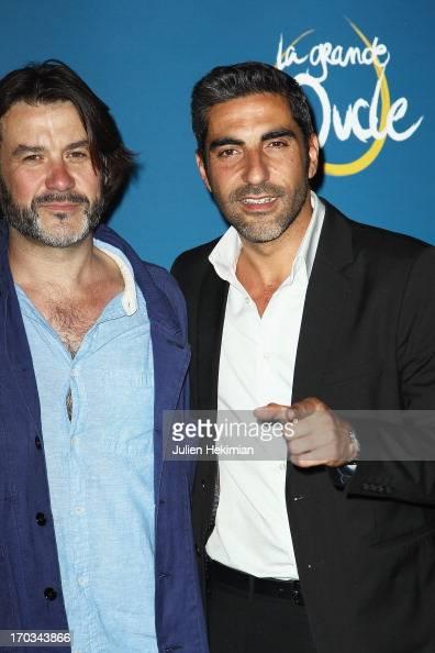 Laurent Tuel and Ary Abittan attend 'La Grande Boucle' Paris Premiere at Gaumont ChampsElysees on June 11 2013 in Paris France
