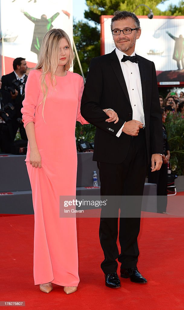 Laurent Vinay holds the arm of actress Sophie Kennedy Clark wearing a Jaeger-LeCoultre Reverso Duetto Cordonnet watch during the Opening Ceremony and 'Gravity' Premiere during the 70th Venice Film Festival at the Palazzo del Cinema on August 28, 2013 in Venice, Italy.