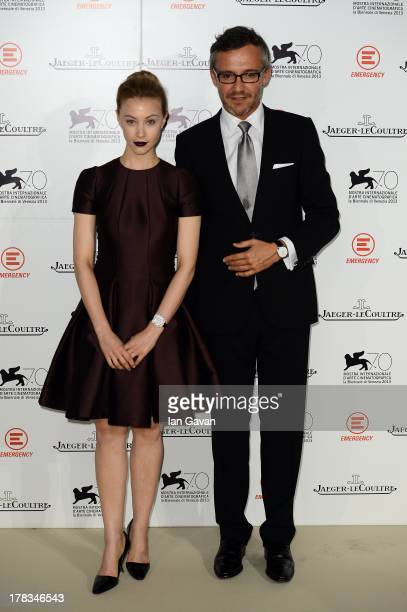 Laurent Vinay poses with actress Sarah Gadon wearing JaegerLeCoultre watches while attending the 'Emergency JaegerLeCoultre In Aid Of The Goderich...
