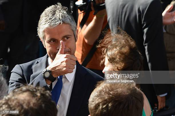 Laurent Wauquiez departs from the UMP headquarters after an extraordinary meeting of UMP rightwing opposition party July 8 2013 in Paris France