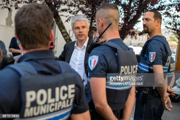 Laurent Wauquiez president of AuvergneRhonesAlpes regional council meets policemen as he visits a municipal police station on May 23 in Mions near...