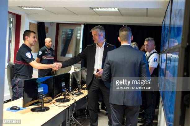Laurent Wauquiez president of AuvergneRhonesAlpes regional council meets policemen in a security footage room as he visits a municipal police station...