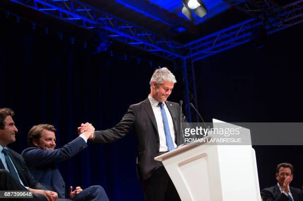 Laurent Wauquiez president of AuvergneRhonesAlpes regional council gestures with Francois Baroin French rightwing Les Republicains party senator and...