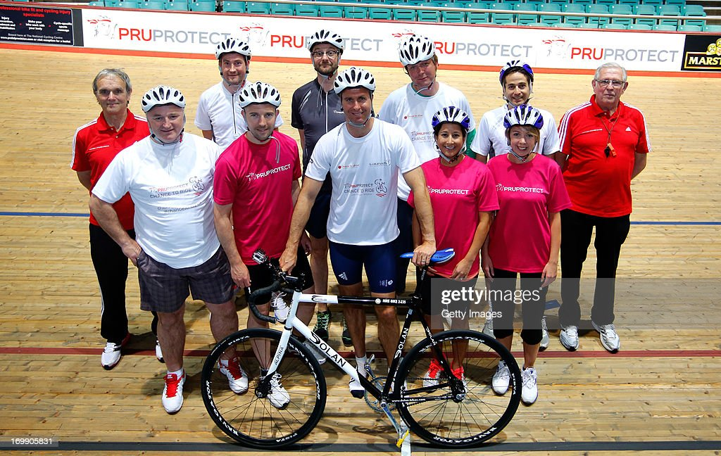 Laureus Academy Ambassador Michael Vaughan poses for a photograph during the PruProtect Chance to Ride Launch at the National Cycling Centre on June...