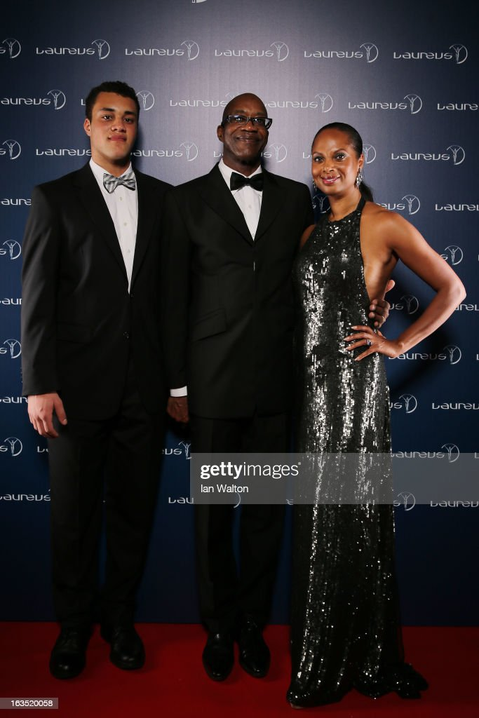 Laureus Academy Chairman Edwin Moses and wife Michelle Moses and guest pose in the winners studio during the 2013 Laureus World Sports Awards at Theatro Municipal do Rio de Janeiro on March 11, 2013 in Rio de Janeiro, Brazil.