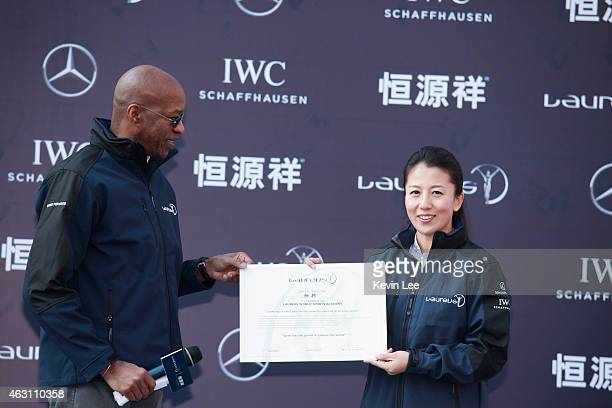 Laureus Academy Chairman Edwin Moses presents a certificate of member of Laureus Sports Award to Yang Yang at Oriental Pearl Tower in Shanghai on...