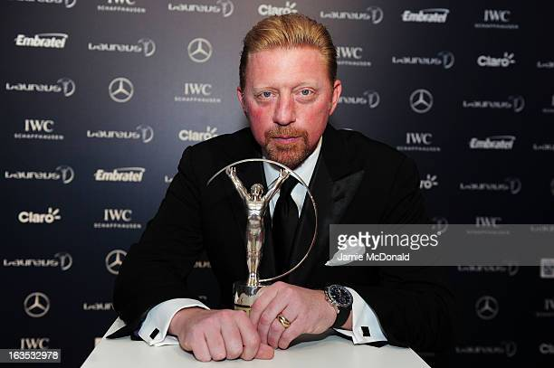 Laureus Academy Member Boris Becker poses with the trophy at the 2013 Laureus World Sports Awards at the Theatro Municipal Do Rio de Janeiro on March...