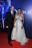 Laureus Academy Member Cathy Freeman and guest attend the 2013 Laureus World Sports Awards at the Theatro Municipal Do Rio de Janeiro on March 11...
