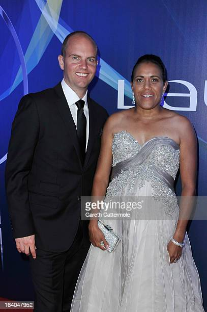 Laureus Academy Member Cathy Freeman and guest pose with the tropy at the 2013 Laureus World Sports Awards at the Theatro Municipal Do Rio de Janeiro...