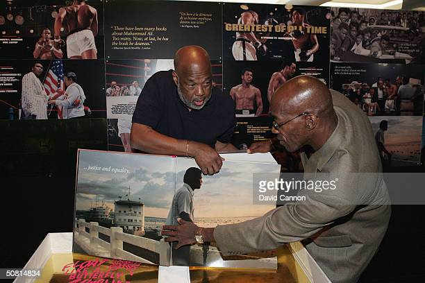 Laureus Academy Member Edwin Moses pose for a picture next to photographer Howard Bingham as they reveal Bingham's book GOAT May 8 2004 at the casino...