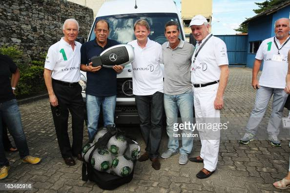 Laureus Academy Member Franz Beckenbauer with Carlos Alberto and Dr Joachim Schmidt Executive Vice President of Sales Marketing for MercedesBenz Cars...