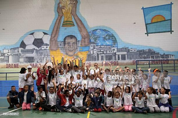 Laureus Academy Member Hugo Porta and Cafu poses with kids at the Fundacao Cafu on November 3 2015 in Sao Paulo Brazil