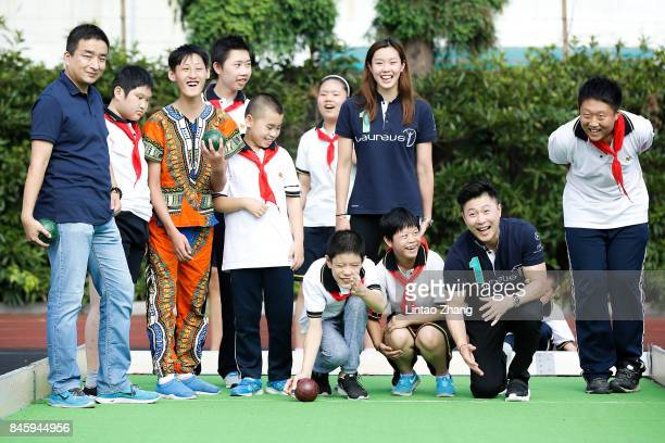 Laureus Academy Member Li Xiaopeng and Stephanie Au play with Hou Ye during the visit to Special Olympics of the IWC Watch Drawing Competition at...