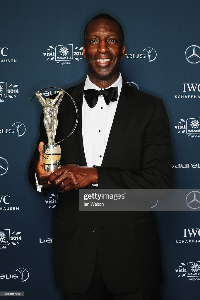Laureus Academy member Michael Johnson poses with the trophy during the 2014 Laureus World Sports Awards at the Istana Budaya Theatre on March 26, 2014 in Kuala Lumpur, Malaysia.