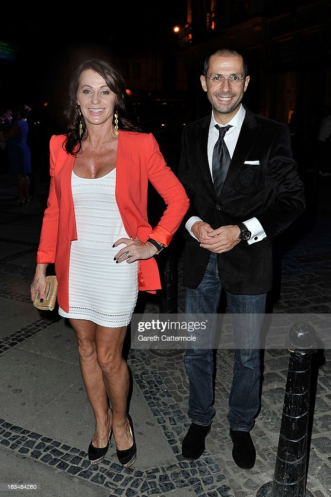 Laureus Academy Member Nadia Comaneci and guest attends the Laureus Welcome Party at the Rio Scenarium during the 2013 Laureus World Sports Awards on...