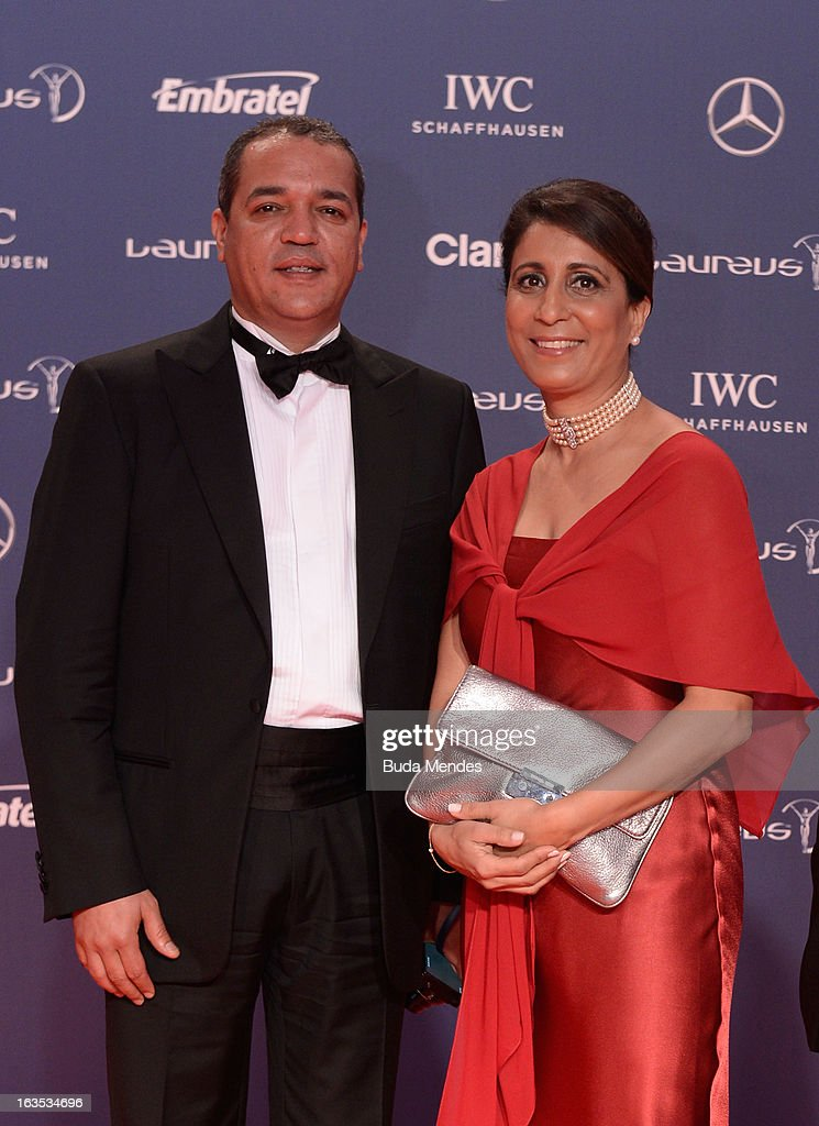 Laureus Academy Member <a gi-track='captionPersonalityLinkClicked' href=/galleries/search?phrase=Nawal+El+Moutawakel&family=editorial&specificpeople=215203 ng-click='$event.stopPropagation()'>Nawal El Moutawakel</a> and guest attends the 2013 Laureus World Sports Awards at the Theatro Municipal Do Rio de Janeiro on March 11, 2013 in Rio de Janeiro, Brazil.