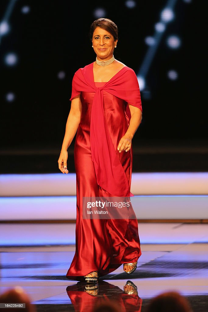 Laureus Academy Member <a gi-track='captionPersonalityLinkClicked' href=/galleries/search?phrase=Nawal+El+Moutawakel&family=editorial&specificpeople=215203 ng-click='$event.stopPropagation()'>Nawal El Moutawakel</a> walks on during the awards show for the 2013 Laureus World Sports Awards at the Theatro Municipal Do Rio de Janeiro on March 11, 2013 in Rio de Janeiro, Brazil.
