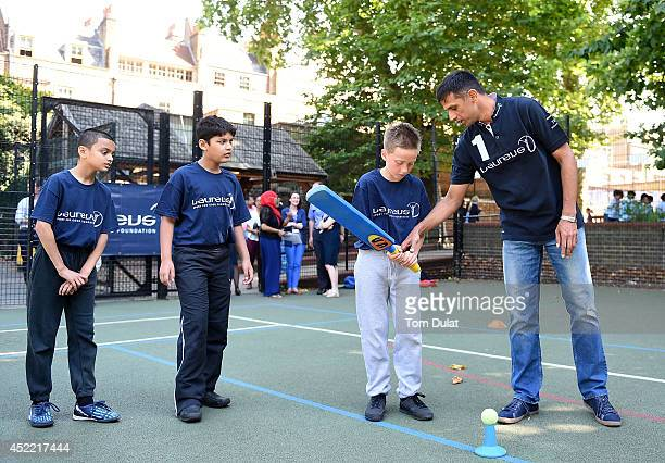 Laureus Academy Member Rahul Dravid interacts with children during the Rahul Dravid Academy Announcement at Christ Church C of E Primary School on...