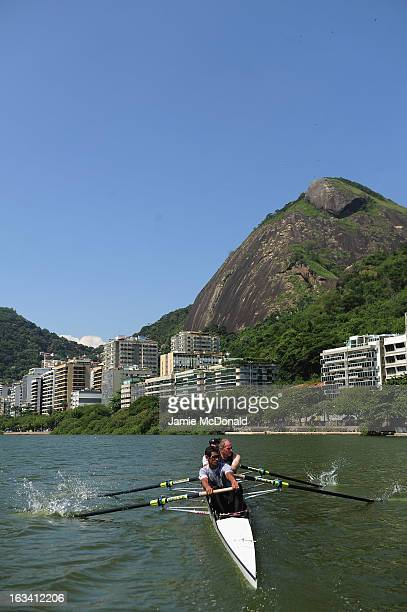 Laureus Academy member Sir Steve Redgrave puts local rowers through their paces during a demonstration at Lake Lagoa during the 2013 Laureus World...