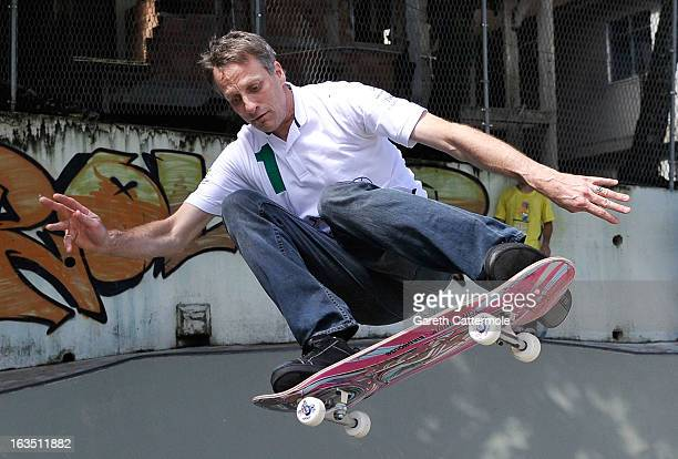 Laureus Academy Member Tony Hawk skateboards with local children attends the Laureus visit to Rocinha during the 2013 Laureus World Sports Awards on...