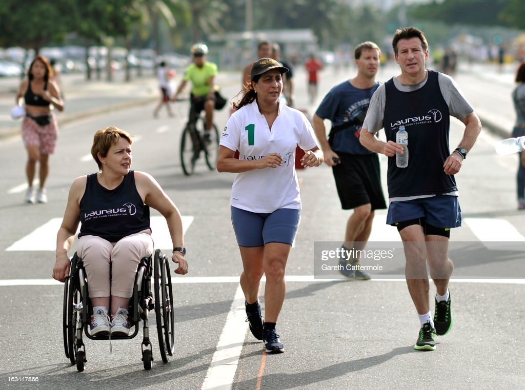 Laureus Academy Members Tanni Grey - Thompson,<a gi-track='captionPersonalityLinkClicked' href=/galleries/search?phrase=Nawal+El+Moutawakel&family=editorial&specificpeople=215203 ng-click='$event.stopPropagation()'>Nawal El Moutawakel</a> and Lord <a gi-track='captionPersonalityLinkClicked' href=/galleries/search?phrase=Sebastian+Coe&family=editorial&specificpeople=160624 ng-click='$event.stopPropagation()'>Sebastian Coe</a> in action during the Laureus Run Copacabana Beach on March 10, 2013 in Rio de Janeiro, Brazil.