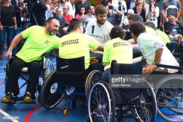 Laureus Ambassador and FC Barcelona player Gerard Pique shakes hands with his teammates during a korfball match at the Insitut Guttmann on April 9...