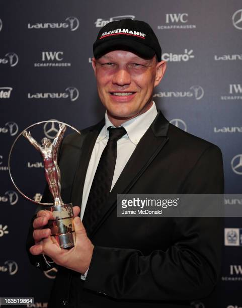 Laureus Ambassador Axel Schulz poses with the trophy at the 2013 Laureus World Sports Awards at the Theatro Municipal Do Rio de Janeiro on March 11...