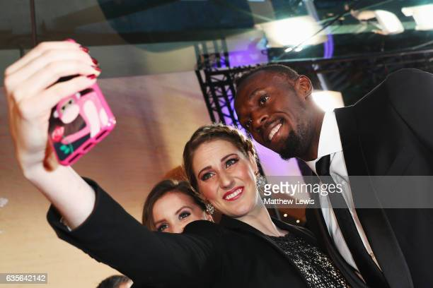 Laureus Ambassador Missy Franklin takes a picture with Laureus World Sportsman of the Year Award nominee Athlete Usain Bolt of Jamaica at the 2017...