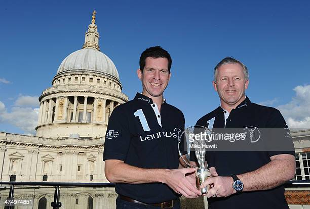 Laureus Ambassador Tim Henman and Laureus Academy Vice Chairman Sean Fitzpatrick pose for a photo in front of St Paul's Cathedral during the Laureus...