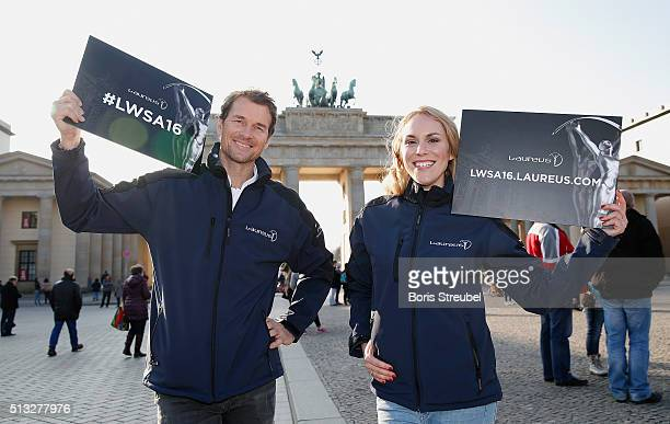 Laureus ambassadors Kathi Woerndl and Jens Lehmann pose with Laureus signature at Brandenburg Gate during the Berlin Nominations for the Laureus...