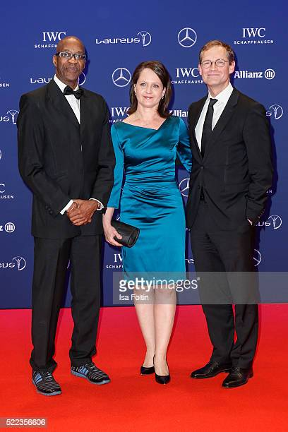 Laureus Chairman Edwin Moses with the Mayor of Berlin Michael Mller and his wife Claudia Mueller attend the Laureus World Sports Awards 2016 on April...