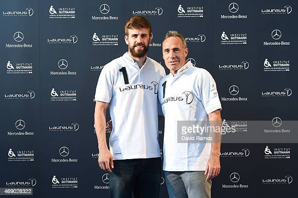 Laureus Foundation ambassadors FC Barcelona player Gerard Pique and former tennis player Alex Corretja pose for a picture on April 9 2015 in...